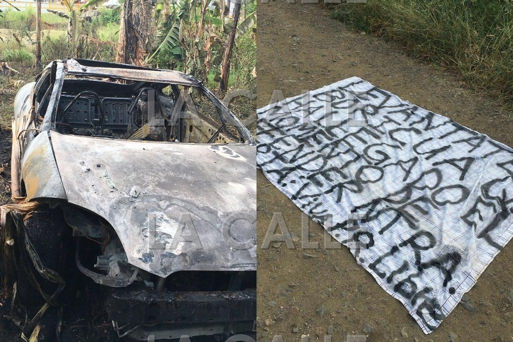 """Parte de los daños causados por las bombas """"Molotov"""" y la pancarta recuperado en la escena (Suministradas Policía)."""