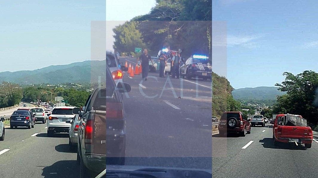 La escena del accidente y el tapón que provocó el mismo en la carretera PR-2 desde Sabana Grande (Suministradas).