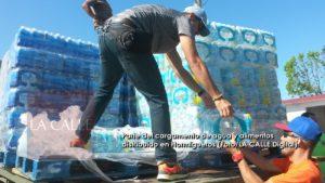 Distribuyen suministros y agua a residentes de sectores de Hormigueros (Fotos)